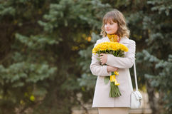 Cute little girl with yellow roses awaiting appointment Royalty Free Stock Photos