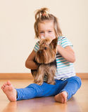 Cute little girl with yorkshire terrier indoor Royalty Free Stock Images