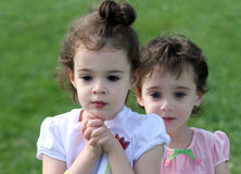 Cute little girls. An outdoor portrait of two 4 year old girls Royalty Free Stock Photos