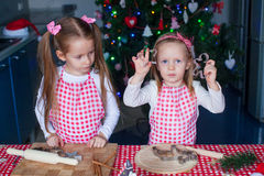 Cute little girls baking ginger cookies for Stock Image