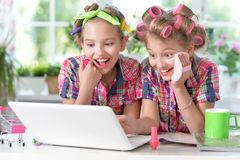 Cute little girls beautifying themselves royalty free stock photo