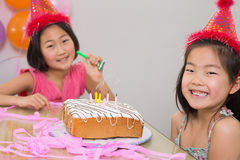 Cute little girls at a birthday party. Closeup portrait of cute little girls at birthday party Royalty Free Stock Photography