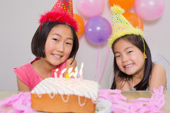 Cute little girls at birthday party. Closeup portrait of cute little girls at birthday party Royalty Free Stock Images