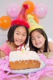 Cute little girls at birthday party. Closeup portrait of cute little girls at birthday party Stock Photos