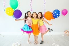 Adorable little girls at birthday party indoors. Cute little girls at birthday party indoors Stock Photo