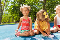 Cute little girls draw with chalk Stock Photography
