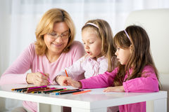Cute little girls drawing Stock Images