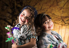 Cute little girls dressed as a traditional witches stock photos