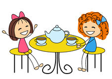Cute little girls drinking tea Stock Photography