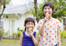Cute little Girls  Eating Ice Cream Stock Photos