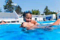 Cute little girls enjoying in pool stock photos