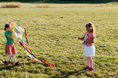 Cute little girls flying a kite Stock Image