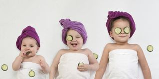 Cute little girls getting beauty treatment royalty free stock photo