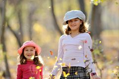 Cute little girls in the park Stock Images