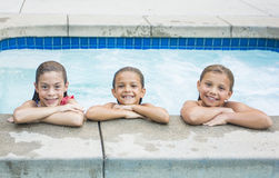 Cute little girls playing in the pool Stock Photo