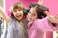 Cute little girls playing with their mother`s stuff. At home royalty free stock photography