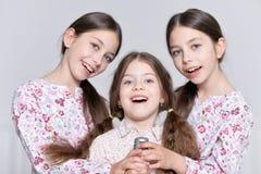 Cute little girls posing. Portrait of a cute little girls posing stock photo