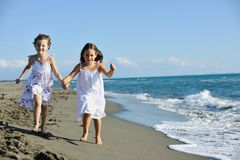 Cute little girls running on beach Royalty Free Stock Photo