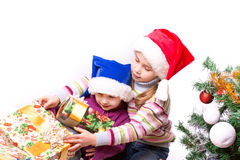 Cute little girls in Santa's hat Royalty Free Stock Photos