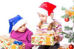 Cute little girls in Santa's hat Stock Image