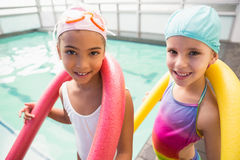Cute little girls smiling poolside Royalty Free Stock Photography