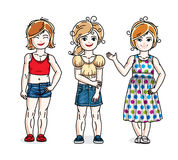 Cute little girls standing in stylish casual clothes. Vector set Stock Photography