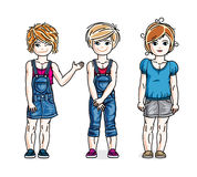 Cute little girls standing in stylish casual clothes. Vector set Royalty Free Stock Photos