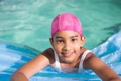 Cute little girls swimming in the pool Royalty Free Stock Photo