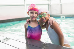Cute little girls in the swimming pool Stock Photos