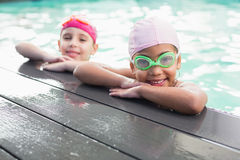Cute little girls in the swimming pool Stock Photo