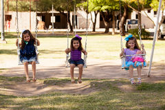 Cute little girls on a swing Royalty Free Stock Image