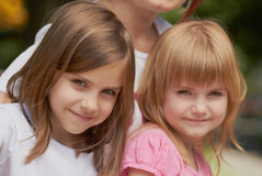 Cute little girls with their mom outdoors Royalty Free Stock Images