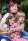 Cute little girls with their mom outdoors Royalty Free Stock Image