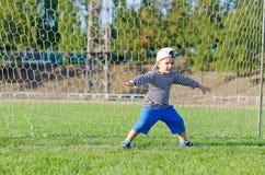 Cute little goalkeeper Royalty Free Stock Image