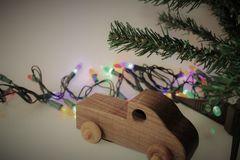 Handmade Toy Wood Car with Christmas Lights royalty free stock photo