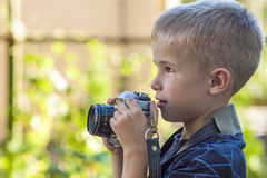 Cute little happy boy with vintage  camera outdoors Stock Photography