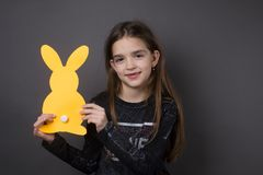 So cute little happy girl with bunny. So cute little happy girl with one yellow paper bunny Royalty Free Stock Photo