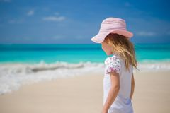 Cute little happy girl playing at exotic beach Stock Photos
