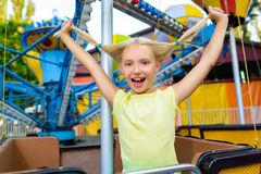 Cute little happy smiling girl riding a Carnival Royalty Free Stock Image