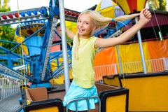 Cute little happy smiling girl riding a Carnival Stock Photo