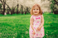 Cute little happy toddler girl portrait walking in spring or summer park Royalty Free Stock Photography