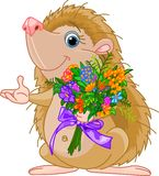 Cute little Hedgehog giving a bouquet royalty free stock photography