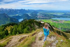 Free Cute Little Hiker Enjoying Picturesque Views From The Tegelberg Mountain, A Part Of Ammergau Alps, Located Nead Fussen Town, Germa Stock Photo - 113203400