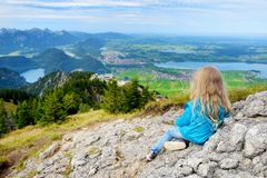 Free Cute Little Hiker Enjoying Picturesque Views From The Tegelberg Mountain, A Part Of Ammergau Alps, Located Nead Fussen Town, Germa Royalty Free Stock Photo - 113264485