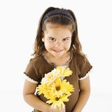 Cute little hispanic girl with bouquet. Royalty Free Stock Photos