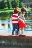 Cute little hugging children on the promenade stock photos