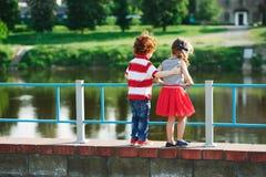 Cute little hugging children on the promenade royalty free stock photo
