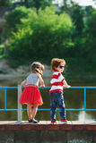 Cute little hugging children on the promenade royalty free stock image