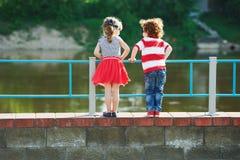 Cute little hugging children on the promenade stock photo