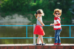 Cute little hugging children on the promenade stock image